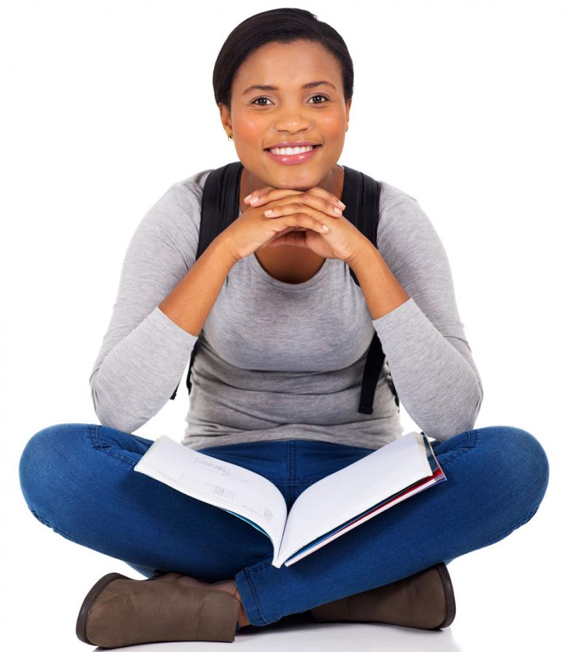 Smiling girl sitting with open book